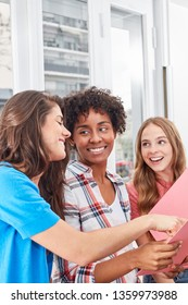 Three young women as friends or students learn together in teamwork
