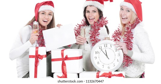 three young women in hats of Santa Claus with Christmas gifts