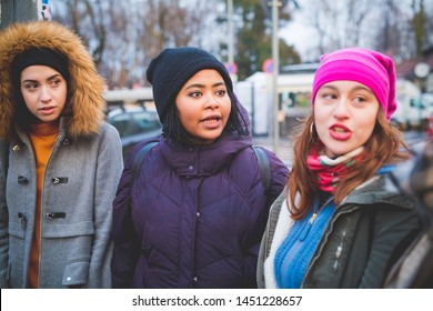 three young women interacting and walking outdoor– cheerful, dynamic, youth