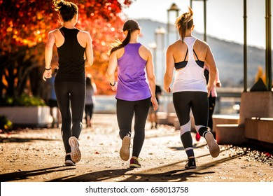 three young women running