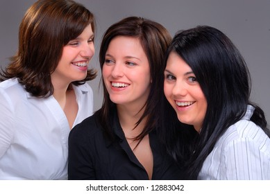 Three Young Women Talking And Having Fun