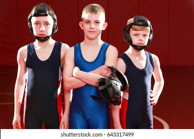 Three youth wrestlers