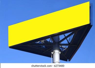 a three-cornered ikea sign and blue sky