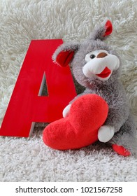 three-dimensional red letter on a light background