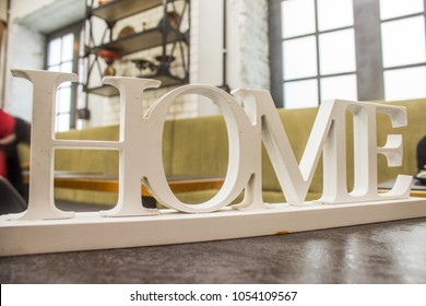 three-dimensional wooden font of the word home ,