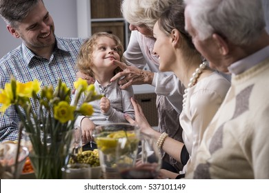 Three-generation family enjoying festive meal on the Easter day