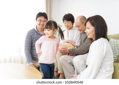 Three-generation family taking care of dog