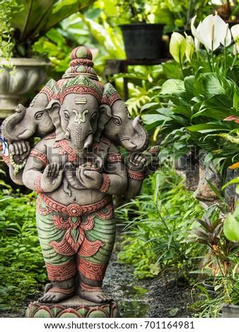 Three Headed Deity Ganesh Statue, Standing In The Garden