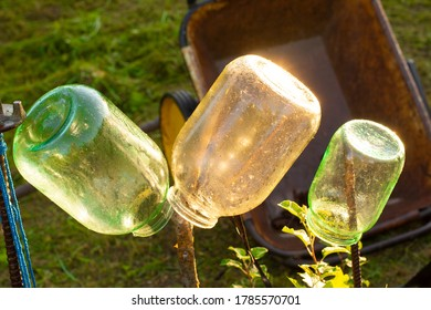 Three-liter glass jars on the street are dried after washing.