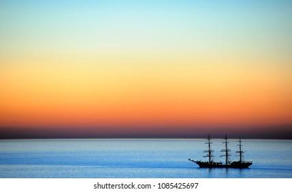 Three-master at sunset at the North Sea