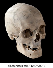 Three-quarter angle of the human skull. A human skull with a toothless mouth. Isolated on black.