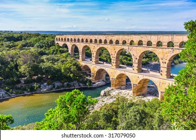 Three-tiered aqueduct Pont du Gard was built in Roman times on the river Gardon. Around the bridge is magnificent natural park. Provence, spring sunny day