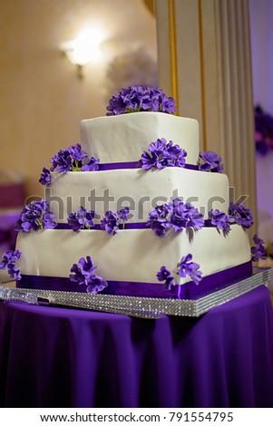 Threetiered white cake purple flowers stock photo edit now three tiered white cake with purple flowers mightylinksfo