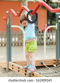 Three-year girl at playground area in summer