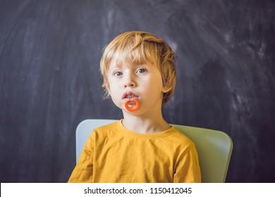 Three-year old boy shows vestibular plate. Plate with a bead to stimulate the tongue. dysarthria, rhinolalia