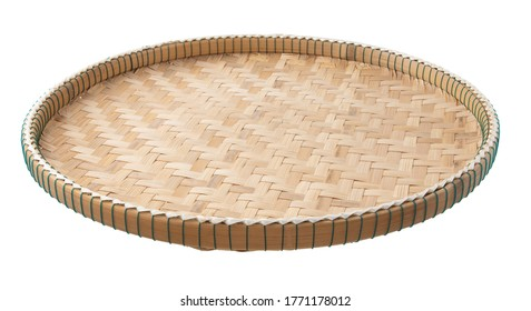 Threshing basket made from bamboo weave isolated on white background with clipping path. Thai traditional kitchenware.