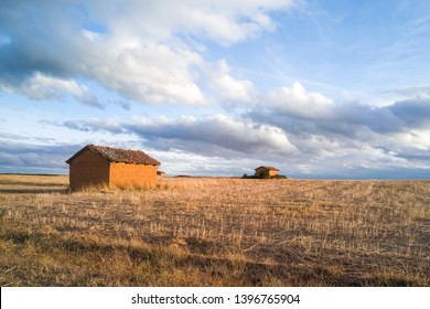 Threshing floor in the village, in autumnal landscape with adobe huts that were used to store threshing implements