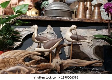 Thrift shop random items (Birds, minature ships, metal mini piano, skelton, and plants.)