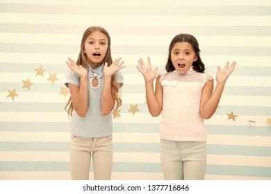 Thrilled moment from childhood. Kids schoolgirls preteens shocked. Girls surprised shocked faces thrilled expression stand striped background. Girls children best friends wonder about surprising news.