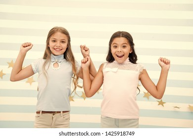 Thrilled moments together. Kids schoolgirls preteens happy together. Girls smiling happy faces excited expression stand striped background. Girls children best friends thrilled about surprising news.