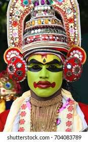 THRIPPUNITHURA, INDIA - AUGUST 25: Procession during harvest festival Onam celebration. Man wearing Kathakali costume an Indian traditional dance drama on August 25, 2017 Kerala, South India.
