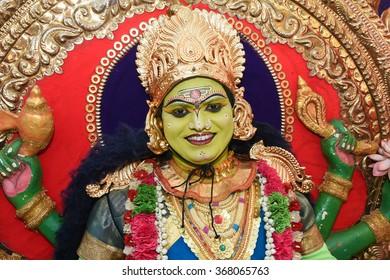 THRIPPUNITHURA, INDIA - SEPT 11: Man dressed as Hindu Goddess Saraswathi part of the trinity Saraswati, Lakshmi and Parvati during festival of Onam. September 11, 2015 in Thrippunithura, Kerala,India.
