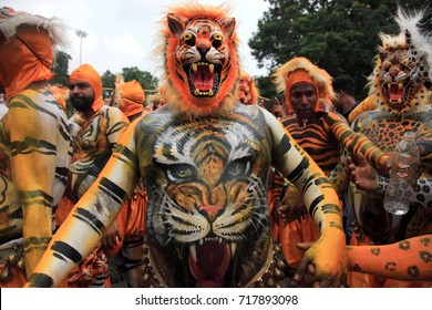 THRISSUR, INDIA - SEP 07:Body painted people perform 'tiger dance' on September 07, 2017 at Swaraj round in Thrissur, Kerala,India. Tiger dance is a traditional item performed during  Onam festival.