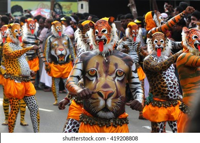 THRISSUR, INDIA - SEPT 10: Body painted tiger dance artists perform at Swaraj round on September 10, 2014 in Thrissur, Kerala,India. Tiger dance is a traditional dance performed during Onam festival.