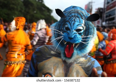 THRISSUR, INDIA - SEPT 19: Body painted tiger dance artists perform at Swaraj round on September 19, 2013 in Thrissur, Kerala,India. Tiger dance is a traditional folk art performed during Onam.