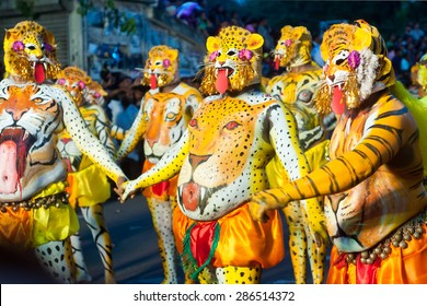 THRISSUR, INDIA - SEPT 19: Body painted artists perform at Swaraj round on September 19, 2013 in Thrissur, Kerala,India. Tiger dance is a traditional folk art performed during Onam.