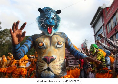 THRISSUR, INDIA - SEPT 19: Body painted tiger dance artists perform at Swaraj round on September 19, 2013 in Thrissur, Kerala,India. Tiger dance is a traditional dance performed during Onam festival.