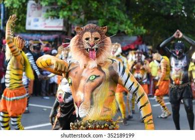 THRISSUR, INDIA - SEPT 28: Body painted artists perform at Swaraj round on September 28, 2015 in Thrissur, Kerala,India. Tiger dance is a traditional folk art performed during Onam.