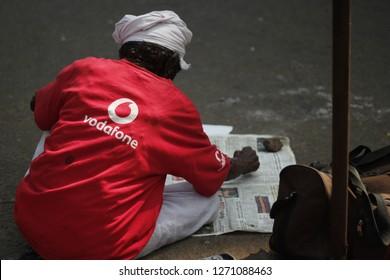 Thrissur, Kerala, India - Dec 2012 : A homeless person wearing Vodafone T-shirt on streets of Kerala, beggar man
