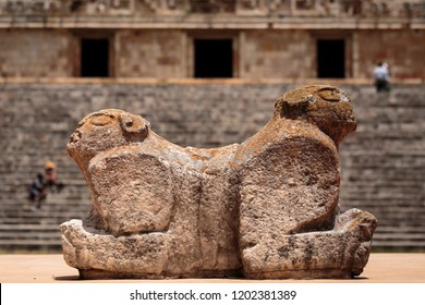 Throne of the two-headed jaguar. In the background is the Palacaio del Gobernador or Governor's Palace, in the Ancient Mayan city of Uxmal, Yucatán, Mexico. Horizontal view.
