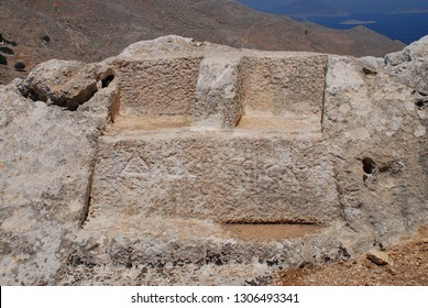 The thrones of Greek gods Zeus and Hekate carved in stone in the hills above Chorio on the Greek island of Halki. The inscribed stones date from the Hellenistic period of ancient Greece (323-31 BC).