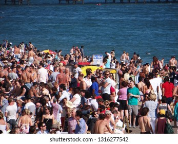 Throngs and Crowds of people on the seafront, Brighton, England, May 2012
