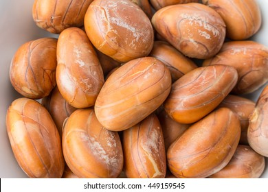 Through boiled Jackfruit seeds ready to eat in white plate with isolated on white background. Closeup image