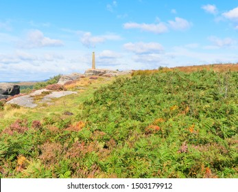 Through lush ferns and heather to Admiral Nelsons monument perched on top of Birchen Edge in the Derbyshire Peak District National Park