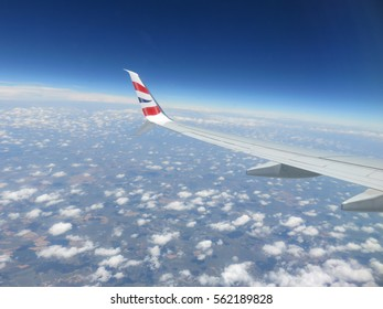 Through a plane window.