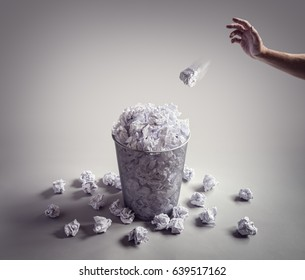 Throw it in the waste paper basket or bin concept for business frustration, stress and writers block