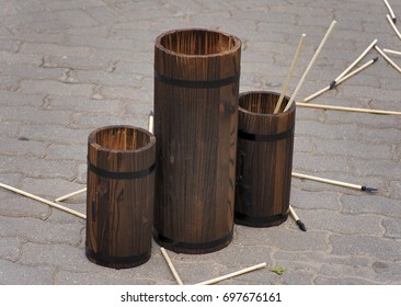 Throwing arrows into wooden vases. Korean game.