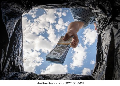 throwing away dollars in trashcan. Getting rid of excess cash, switching to non-cash payment. The concept of inflation.