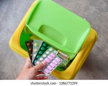 throwing away expired medicine pills in pack in trash can