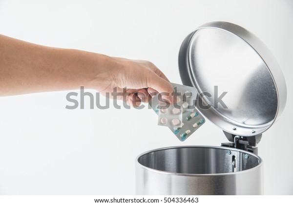 throwing away medecine in trashcan