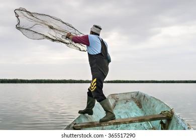 Throwing out fishing net on the lake near Kanjiza, Serbia