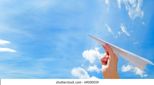 Throwing a paper plane in the sky. Freedom, success, vacation, business concepts