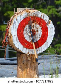 Thrown axe in bullseye, lumberjack competition Canada