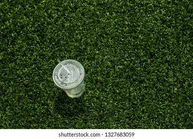Thrown out cup on astroturf