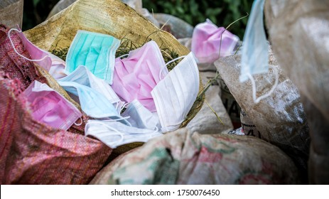 Throws out a medical face mask. Used hygienic mask the trash bin. Prevented coronavirus by separating infected waste. Useless hygienic mask.