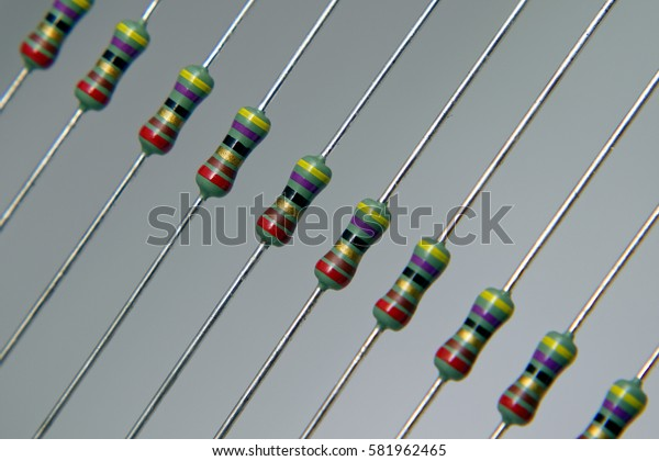 Thru hole mounting resistors on a grey background
